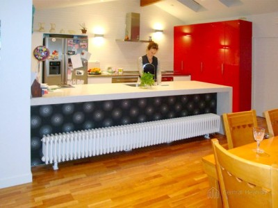 DeLonghi Multicolonna radiator beneath kitchen bench