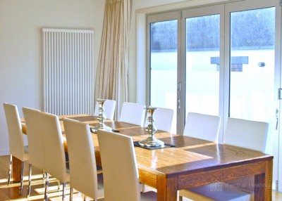 DeLonghi Multicolonna vertical radiator in dining room